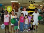 Children's Health Fair Chairman, Gwen Anderson with the children.